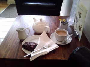 Tea and a chocolate brownie at Delicious...