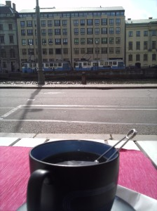Tea and a view of the river and a tram at Cafe hamngatan
